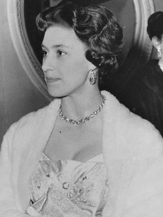 HRH Princess Margaret wearing a pair of sapphire and diamond earrings and a diamond collet necklace she inherited from her grandmother Queen Mary.