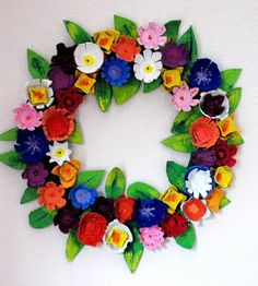 This entire wreath is made of egg cartons. Beautiful, a craft for the kids, and a great way to reuse those Easter egg cartons!