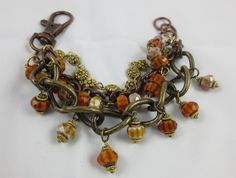 Amber and Bronze Beaded Charm Bracelet by Unfeather by Robyn on Etsy
