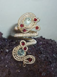 "Ring from the parure: ""Scarborough Fair"". Aquamarine, Garnets, Sterling Silver"