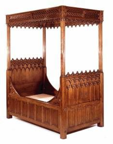 Gothic wooden bed. Notice the panels around the bottom indicative of Gothic drapery