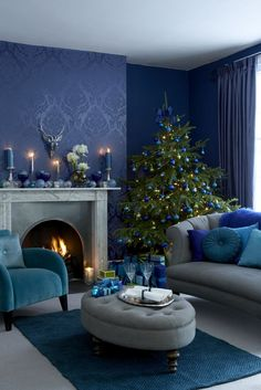 For a smart and contemporary, build a scheme with toning shades of deep blue, using a dramatic wallpaper or rug as the starting point. Pick out the darkest blue for baubles and cushions, teamed with hints of green and turquoise. Photography: Mark Scott and Oliver Gordon. housebeautiful.co.uk