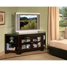 In a rich espresso color, this handsome television stand fits perfectly with any room's decor. Made of pine, this 62-inch stand is as strong and durable as it is attractive.
