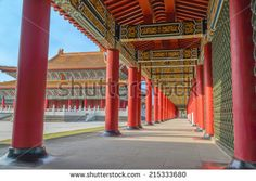 Corridor of A Confucius Temple and The Main Building of The Temple, Under Blue Sky. A  Stereo Type of Traditional Chinese Palace Architecture. The Temple is a Tourist Site in  Kaohsiung, Taiwan.