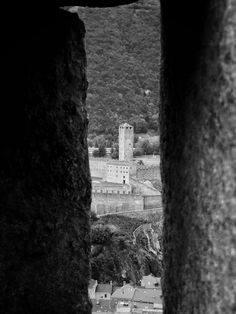 Castelgrande can be seen through a loophole of Montebello castle / Clickasnap Castle Wall, See Through, All Pictures, Monochrome, Canning, Monochrome Painting, Conservation