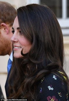 Kate's brunette locks were looking even more bouncy and glossy than usual today