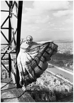 Lisa Fonssagrives on the Eiffel Tower, Paris 1939 by Erwin Blumenfeld