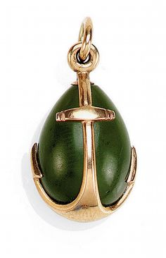 A FABERGÉ GOLD-MOUNTED NEPHRITE EGG PENDANT, WORKM -   height: 1.8cm, 3/4 in  the body overlaid with two conjoined anchors, 56 standard  PROVENANCE  The Kazan Collection  LITERATURE  M. Ghosn, Objets de Vertu par Fabergé, 1996, no. 155, illustrated.  by Sotheby's