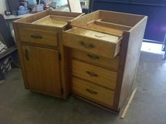 Old cabinets repurposed into a kitchen island.  We did this in our kitchen!  Great idea!