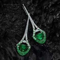 Martin Katz Jewels Inspired by the silhouette of the #EiffelTower, the #MartinKatz Halfmoon #EmeraldEarrings are set with hundreds of emeralds and diamonds.