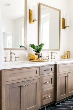 wood bathroom cabinets with gold accents and slate herringbone flooring | Photography: Halli Aldous