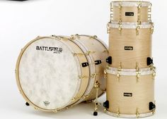 I have been drooling over this Battlefield Drums kit for a while.  I REALLY want to hear how that bass drum sounds.    http://battlefielddrums.com/gallerys/natural-satin-stain