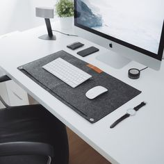 """Cool, sophisticated desk mat with white """"Apple"""" themed setup. I'm not sure I'd have this as my first choice but the desk mat especially is intriguing. Desk Setup, Room Setup, Pc Setup, Workspace Design, Office Workspace, Contract Furniture, Bar Furniture, Workspace Inspiration, Design Inspiration"""