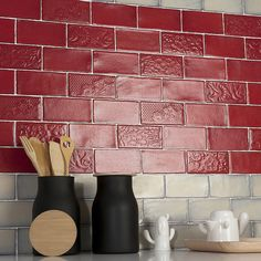 The SomerTile 3x6-inch Antiguo Feelings Red Moon Ceramic Wall Tile will bring unique vintage accents to your home. These subway tiles feature an embossed floral design with a dimensional surface. The