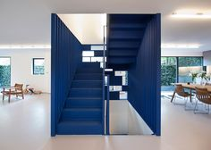 This blue steel staircase, inserted into the home of fashion designer Roksanda…