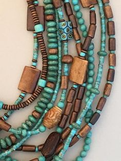 Detail from handcrafted multi-strand statement necklace featuring turquoise, bon. - Detail from handcrafted multi-strand statement necklace featuring turquoise, bone and glass beads. Turquoise Jewelry, Boho Jewelry, Beaded Jewelry, Jewelery, Jewelry Design, Beaded Bracelets, Long Beaded Necklaces, Statement Jewelry, Handmade Jewelry