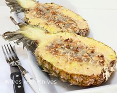 LIFE CHANGING.  I had this Baked Pineapple at a restaurant a few years ago, and it made me moan, it was so good.  Its a baked pineapple, stuffed with coconut, crushed gingersnaps, macadamia nuts, sweetened condensed milk and a bit of rum. Tastes like Hawaii on a plate.~Pinner. SO impressive for a dinner party  simple to do. Assemble ahead of time then bake while everyone is eating the main course.