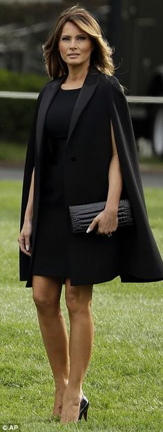 Night and day: Brigitte's cheerful dress featured black buttons and a black ribbon belt that complemented Melania's all-black look