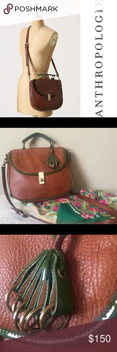 Anthro Pilcro Satchel Anthro satchel by Pilcro in a cognac brown with patent green trim. Crossbody strap and leather ring tassel. Used once; like new condition!!!! Only wear is tiny rub on green trim that is pictured; scratch on turnlock came that way when purchased. Anthropologie Bags Crossbody Bags