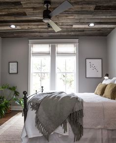 love the wood on the ceiling in this master bedroom