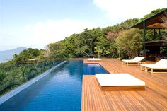 Modern Deck and Pool. love the wood