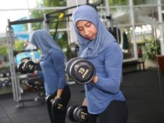 With muscles and tudung, #fitness instructor in M'sia defies #beauty and religious norms #happytuesday
