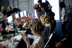 Make-up artists at work at the FF AW13 show, Somerset House