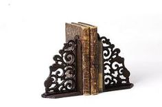 Wrought Iron to prop up place cards bookends.maybe turn them at an angle and add some horizontal wood pieces between to act as a shelf to hold them Muebles Art Deco, Pile Of Books, Book Holders, Iron Work, Book Nooks, Wood Pieces, Decorative Items, Wood Crafts, Cast Iron