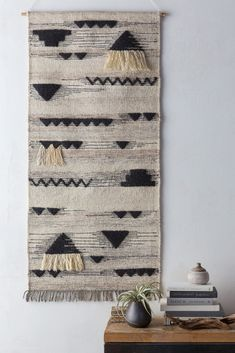 Hand-woven by master artisans, the simultaneously contemporary and ethnic aesthetic of the Asgard Wall Hanging adds a creative tapestry to your wall.