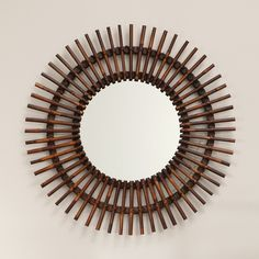 Natural Rattan Sunburst Mirror - 38 diam. in. - About Bassett Bassett Mirror Company, Inc. has been one of America's leading names in home fashion since 1922, when the family business was founded...