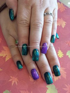 black+and+green+polish+with+purple+glitter+ring+fingers
