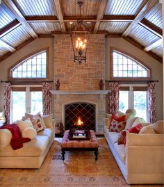 Greenwich Estate traditional family room; perfect red accents; love the drapes and pillows; wood ceilings;