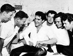 Elvis breaks his finger playing touch football at Graceland. Unknown, Alan Fortas, Elvis, unknown, Sonny West, and Carroll Junior Smith.