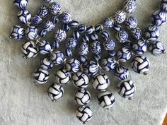 """This fun blue and white necklace looks like a multi-strand but is actually connected into an intricate """"bib"""" style."""