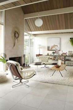 eichler. living room. Beautiful two tone ceiling and beam.