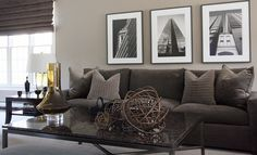 A greige wall color not only underscores this monochromatic space, but it also makes an unassuming backdrop for the subtle black-and-white prints.