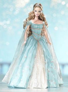 Ethereal Princess Barbie doll casts a regal spell in a blue chiffon gown embellished with a floral design and silvery chiffon front inset. Description from kaboodle.com. I searched for this on bing.com/images