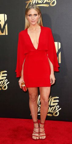 Brittany Snow from MTV Movie Awards 2016 Red Carpet Arrivals Talk about looking Pitch Perfect! The actress looks like a true star in her red V-neck cape dress from Haney. Celebrity Beauty, Celebrity Style, Celebrity News, Nice Dresses, Casual Dresses, Brittany Snow, Cape Dress, Dress Red, Mtv Movie Awards
