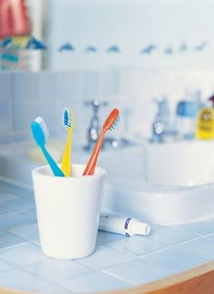 Assign each family member his or her own color and use this as an organizing principle all over the house – each person's toothbrush, towel, laundry hamper and even sheets can be coordinated in the designated shade, making it easy for everyone to find their own stuff and put it away.