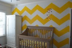 A cheery bright yellow chevron accent wall.  #chevronwall #yellow #nursery