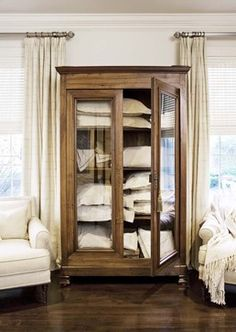 Linen Storage Design, Pictures, Remodel, Decor and Ideas - I have a gun display case that I would like to convert to a linen cabinet like this. Furniture, House, Traditional Bedroom, Interior, Home, House Interior, Interior Design, Bedroom Armoire, Traditional Bedroom Design