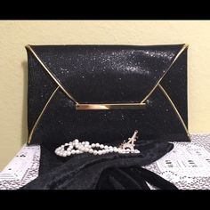 Black Envelope Clutch Black mini sequin envelope clutch with gold trim details! It's classic beauty lies in it's simplicity! Sometimes less really is more. Has two interior pockets and one large main compartment. Brand new without tags. Bags Clutches & Wristlets