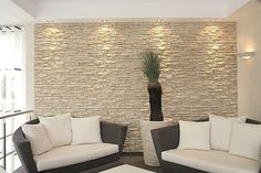 Decorative stone facade wall where new dividing wall will go?