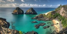 Bahia dos Porcos (Bay of Pigs) and Dois Irmaos (2 Brothers islands) panoramic stitch, not a sweeping panorama, but something more than a wide angle lens can include without horizon distortion.  Fernando de Noronha, Brazil.
