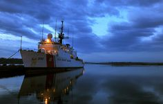 BALTIMORE - Day breaks as the Coast Guard Cutter Thetis is moored at the Coast Guard Yard in Baltimore, February 27, 2011. The Thetis is a 270' medium-endurance cutter that is home ported in Key West and serves the fleet through missions of search and rescue, law enforcement and migrant interdiction. U.S. Coast Guard photo by Petty Officer 3rd Class Matthew Masaschi. #coastie #coastguard