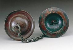 Bronze cymbals, round caps with flat edges linked by a chain, from Pompeii, Campania, Italy. Roman Civilisation, 1st century. Naples, Museo Archeologico Nazionale
