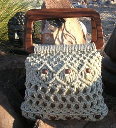 Macrame bag with wood handles standard hippy gear.
