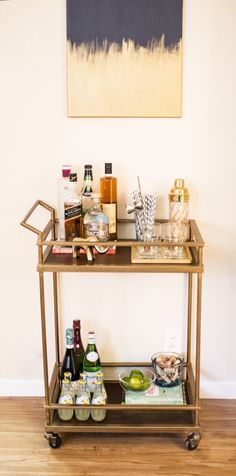 We just got this bar cart as a wedding gift and now I need to accessorize it!