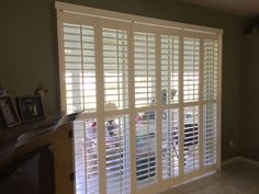 Bifold Plantation #Shutters For Patio Doors. Installation By #BudgetBlinds  #Clermont #Leesburg