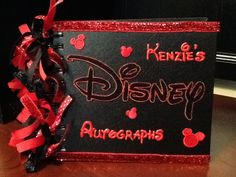 DIY Disney Autograph book (all supplies are from Hobby Lobby...tulip paint, scrap book stickers, scrap book ribbon and a 6x6 sketch book)